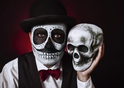 man with mexican calaveras makeup and skull